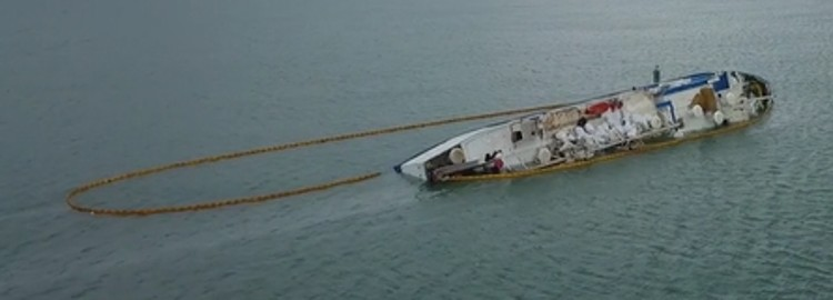 Spill Boom Deployment Around a Capsized Ship